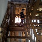 My baby enjoying the wooden staircase