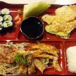 Terriyaki chicken and shrimp bento box with california rolls and vege tempura