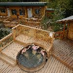 cedar hot tub with suites in the background