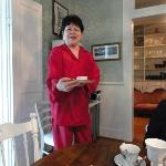 Maugie in her red silk pajamas serving breakfast