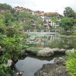 Pond and villas and houses on hill