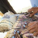 Painstaking handwork to make the fine lace