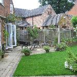 ea Garden - view of the rose patio and garden entry into coffee shop