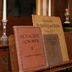 old songbooks grace the piano in the parlor