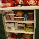 cupboard also loaded with foods