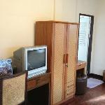 tv, wooden furnitures and in-room refrigerator (not in photo) provided
