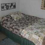 The bed - Note the slump and small bed spread.