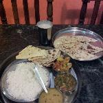 veg thali with butter naan and banana milkshake