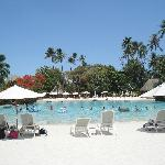 Pool area surrounded by white sand