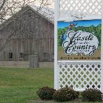 Castle in the Country Sign, old barn across the road serves as backdrop.