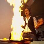 our server tara lightning up a signature dish the 'saganaki'