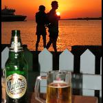 Ferry travellers sunset as seen from Hotel Paros cafe