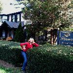 Birthday girl posing in front of the inn.