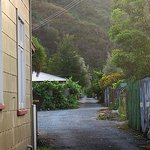 Laneway runs behind Wilsons Hotel parallel to the Broadway. Hillside walk in distance.