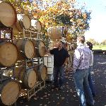 Marty showing the oak barrels