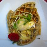 Amazing local poached egg over waffles with a ginger sauce. Wow.