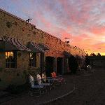 New Mexico sunrise bathes the walls in a lovely pink glow.