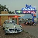 Motorcycles and vintage cars make for a classic scene at the Blue Swallow