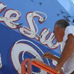 Owner Kevin worked to keep the iconic neon sign looking great.