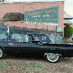 James Dean admires this '57 T-Bird from his place on the wall.