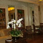 Parlor and library area with tables for breakfast - the orchids are real!