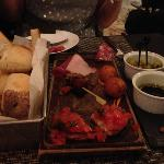 Italian meat platter with breads.