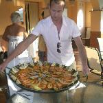 Josh serving the seafood Paella from Antonios Bar Los Pajaritos