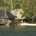 View of a couple of the bungalows from a boat in the bay