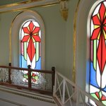 Stained glass windows on the right- in the yellow dome way up above the alter.
