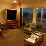 Our living room, looking out to deck, beach, sea beyond