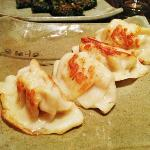 These are the Mandoo, which are fried pork dumplings. Delicious.