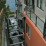 Four storey canyon from cut into hillside. 1006 kitchen window & 1006A balcony.