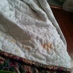 Stains (or burn marks?) on bedding. You can't get new bedding?
