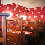 Antique wooden church pews adapted into bar side dining area.