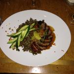 Orange glazed Duck breast, green lentils, zucchini, onions and mustard seed.
