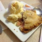 Warm strawberry rhubard pie with ice cream for dessert