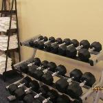 Weights & towels are plenty in the small exercise area.