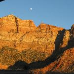 View from our balcony - sunset reflecting on the rock and the moon rising.