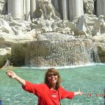 Tossing a coin in the Trevi Fountain