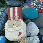 These are some of the hand painted rocks left by past travelers from past years at the lighthous