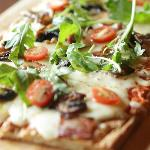 Pizza with Bacon, Cherry Tomatoes, Mushroom and Rocket