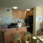 kitchen, fridge/stove island from living room unit 413