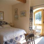 Blue Double bedroom with ensuite shower room and door to garden