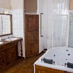 Rustque bathroom with spa bath