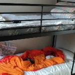 Bunk bed, you'll notice the quality of the sheets and the pillow was flattened