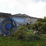 Waterwheel at east end of building
