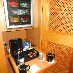 Coffee/tea maker and mini bar.