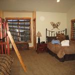 Bedroom with 4 twins (2 bunk beds) and queen bed...huge!