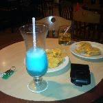 Chilling by the sports bar drinking Blue Ocean n eating Nachos