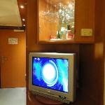 TV set and mini bar.